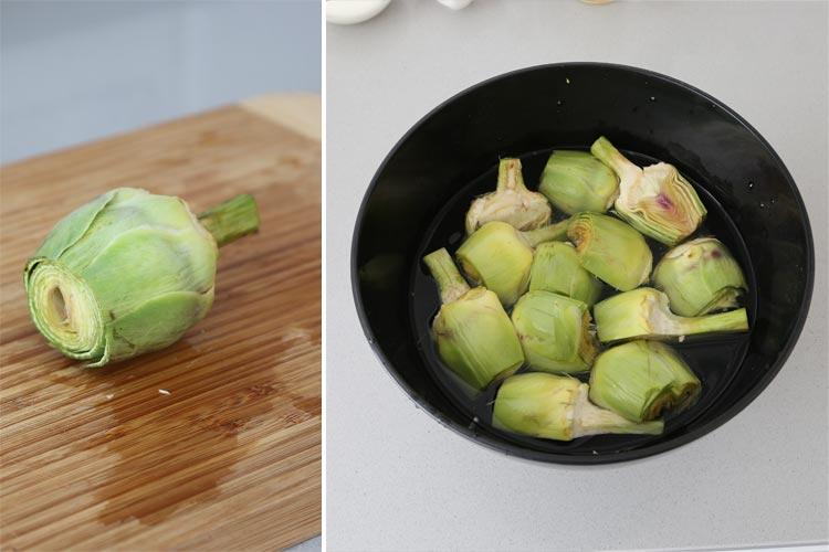 Limpiar las alcachofas y dejarlas agua con zumo de limón o perejil