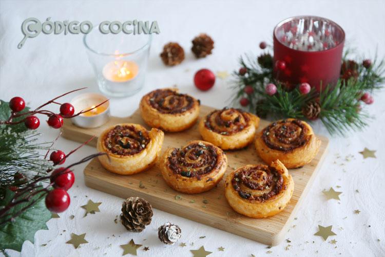 Espirales de hojaldre con tomate seco y queso parmesano
